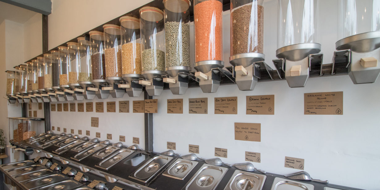 plastic free shopping - dispensers on wall in zero waste shops
